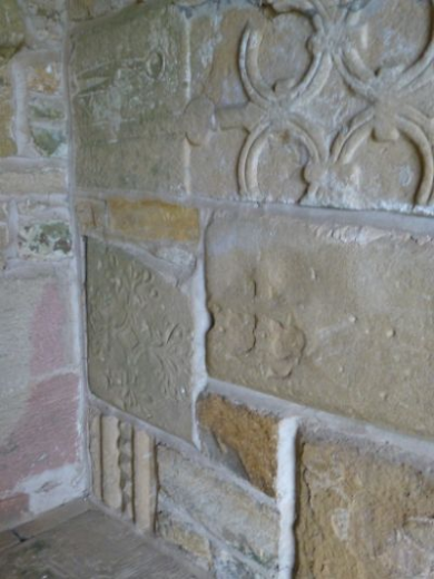 Wensley-reused stone in porch